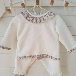 Dainty bear beautiful frilly collar 2 piece tracksuit is made from super soft quilted cotton. Designed for comfort but with a dressy feel this is the perfect addition to your little bear's wardrobe. Classically timeless with floral trim detailing on the neck, cuff's and ankles with a button down back that makes its a versatile piece. Material - 100% cotton