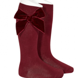 Knee high sock by Condor with velvet bow.